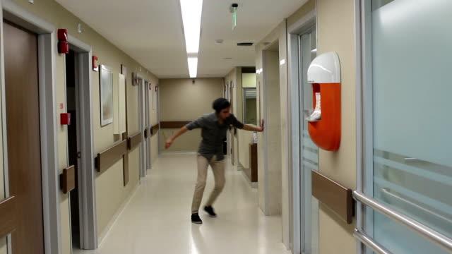 sick man walking in corridor of hospital - drunk stock videos & royalty-free footage