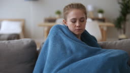 Sick upset woman feeling cold no central heating at home