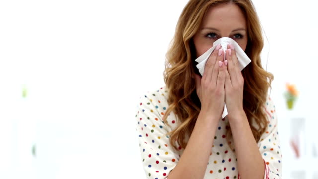 hd: sick woman blowing nose. - facial tissue stock videos & royalty-free footage