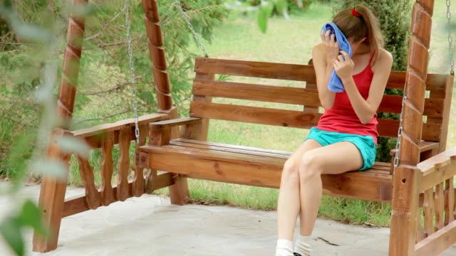 stockvideo's en b-roll-footage met sick woman in her yard - menselijke neus