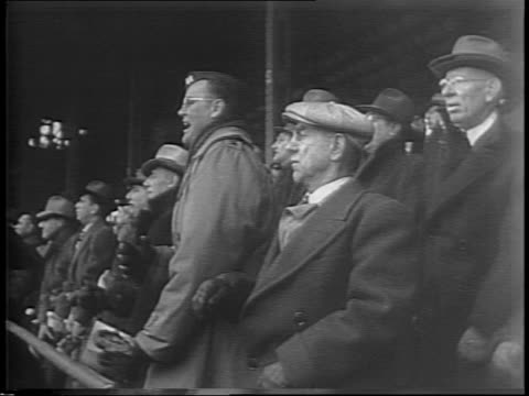 sid luckman passes the ball to dante magnani for chicago touchdown / fans in the stands at wrigley field cheering / luckman passes to magnani to... - 1943 stock videos & royalty-free footage