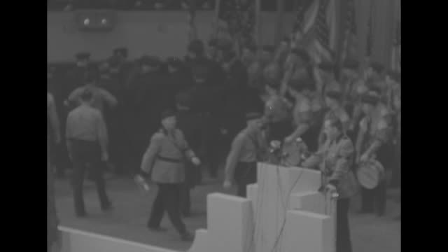 side across audience of the stage at the german-american bund rally at madison square garden, with a portrait of george washington serving as... - ユダヤ教点の映像素材/bロール