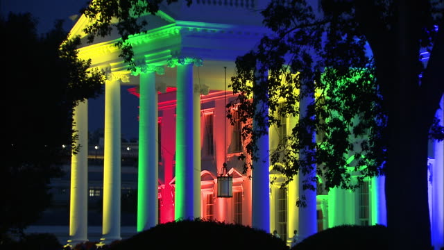 side angle establishing shot of the white house exterior lit up in rainbow colors after the supreme courtõs decision to legalize samesex marriage... - side lit stock videos & royalty-free footage