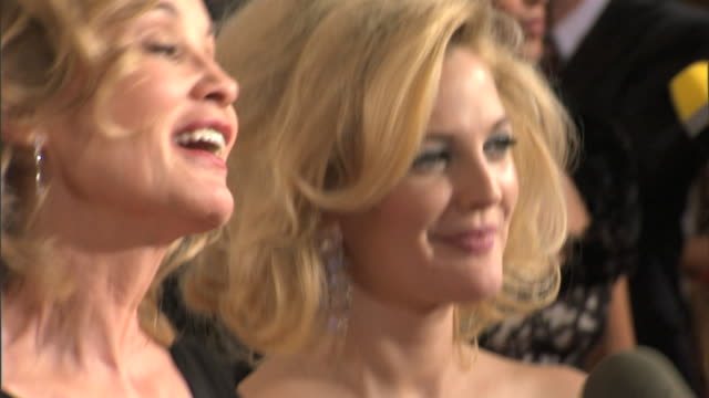 side angle CU Jessica Lange Drew Barrymore nodding head as they speak to unseen correspondent