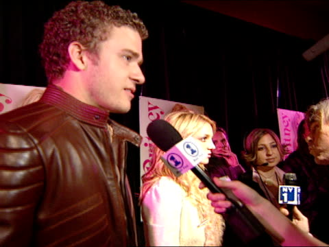 side angle Justin Timberlake and Britney Spears interviewing with various reporters along red carpet at NY night club ZI to profile CU as he talks...