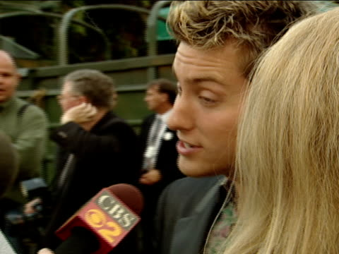 side angle culance bass interviewing w/ cbs news correspondent along red carpet at hollywood bowl - lance bass stock videos and b-roll footage