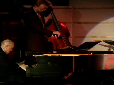 side angle ms ralph sharon playing piano with tony bennett on stage at the rainbow room in new york city - tony bennett singer stock videos and b-roll footage