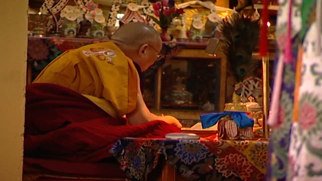 side angle rear pov of hh the dalai lama performing mudras while meditating in tsuglagkhang temple the 14th dalai lama lives in exile in mcleod ganj - meditating stock videos & royalty-free footage