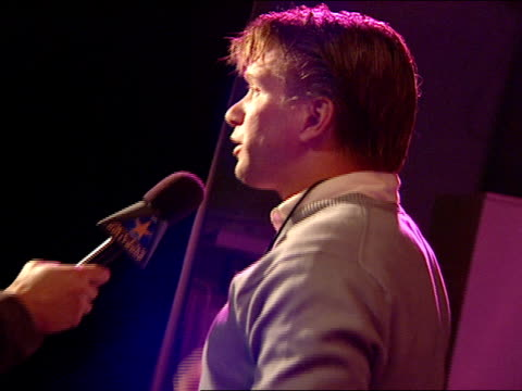 side angle, stephen baldwin interviewing with reporters at night club - stephen baldwin stock-videos und b-roll-filmmaterial