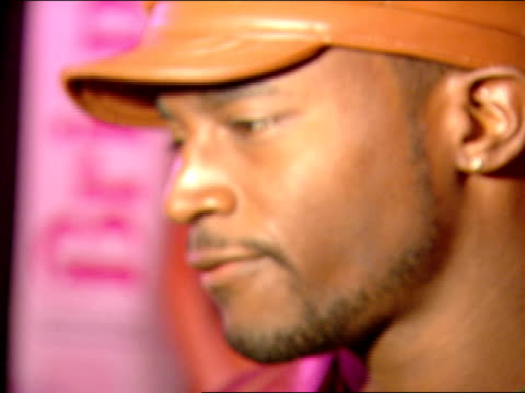 side angle cu zi/ zo to mcu taye diggs speaking to reporters in red carpet at night club - taye diggs stock videos and b-roll footage