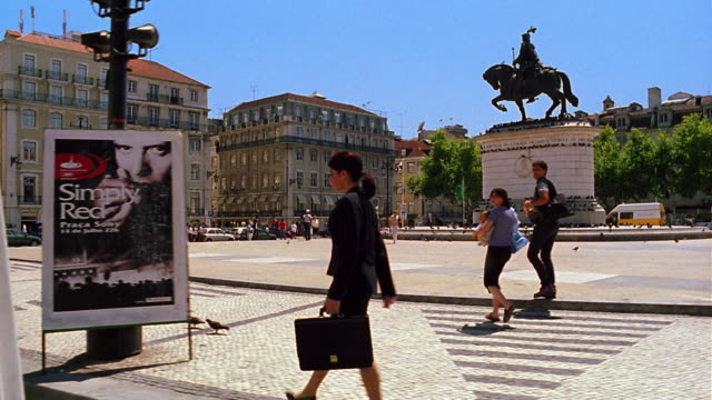 side car point of view pan businesswoman walking in praca de figueria with statue in background / lisbon, portugal - 2000 stock videos and b-roll footage