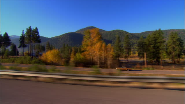 Side car point of view driving along Highway 10 south of Missoula, Montana, on clear day