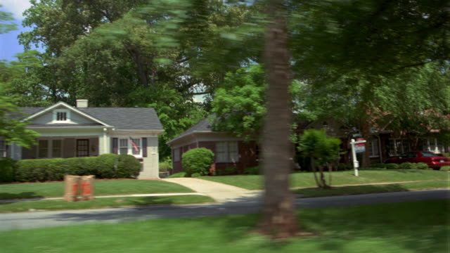side car point of view driving past houses in suburban neighborhood / atlanta, georgia - georgia stati uniti meridionali video stock e b–roll