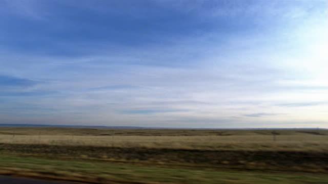 Side car point of view driving past plains / South Dakota