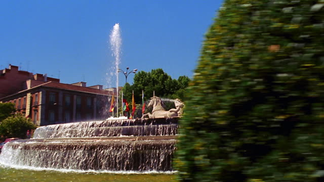 side car point of view fountain of neptune with palace hotel in background / madrid spain - madrid stock videos & royalty-free footage