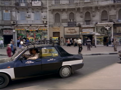 side car point of view in traffic past busy city sidewalks / cairo, egypt - cairo stock videos & royalty-free footage