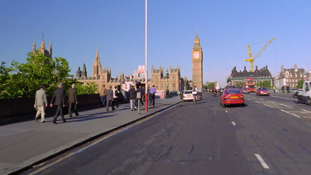 side car point of view passing over westminster bridge with big ben + houses of parliament in foreground / london - ビッグベン点の映像素材/bロール