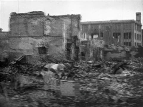 b/w 1923 side car point of view past destruction after earthquake in tokyo / newsreel - 1923 stock-videos und b-roll-filmmaterial
