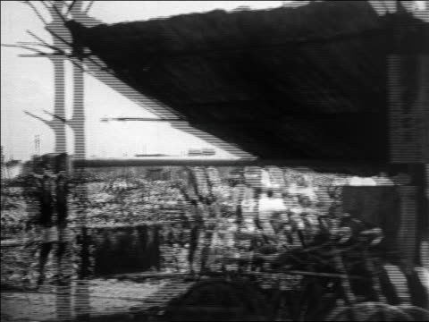 vídeos de stock, filmes e b-roll de b/w 1923 side car point of view past destruction after earthquake in tokyo / newsreel - 1923
