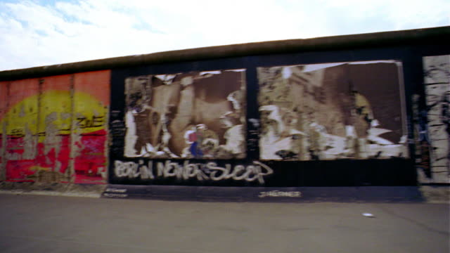 side car point of view past graffiti-covered berlin wall / berlin, germany - graffiti stock videos & royalty-free footage