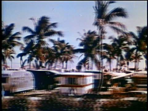 1958 side car point of view past trailers in trailer park/campground / florida / newsreel - 1958 stock-videos und b-roll-filmmaterial