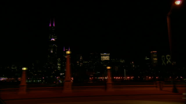 side car point of view skyscrapers in downtown chicago illuminated at night from roosevelt road / sears tower and at&t corporate center / chicago, illinois - societal symbol stock videos & royalty-free footage