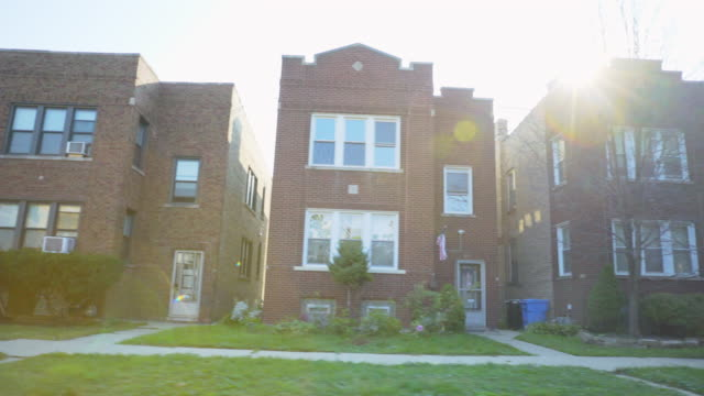 side pov chicago brick two flat apartments - blickwinkel aufnahme stock-videos und b-roll-filmmaterial