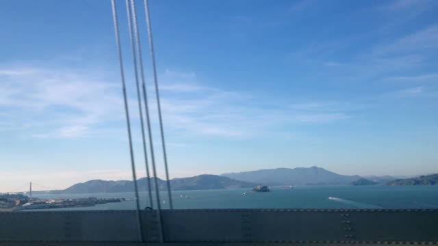 side pov driving over the bay bridge - oakland california stock videos & royalty-free footage