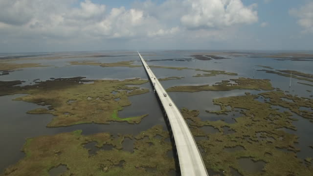 Side flight to forward endless bridge - Drone Aerial 4K Lake Pontchartrain CausewayGrand Isle Louisiana coast Mississippi river bridge and barge everglades, gulf delta, with wildlife 4K Transportation