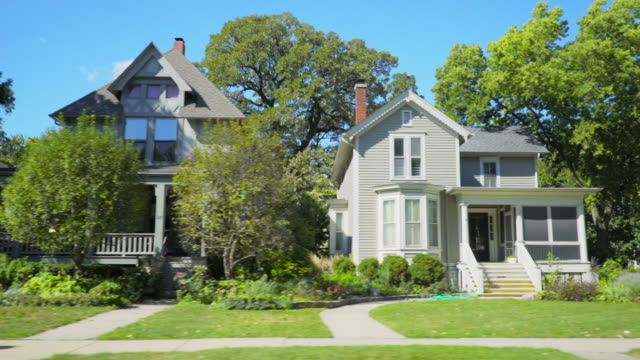 side pov historic neighborhood homes in chicago - suburban stock videos & royalty-free footage