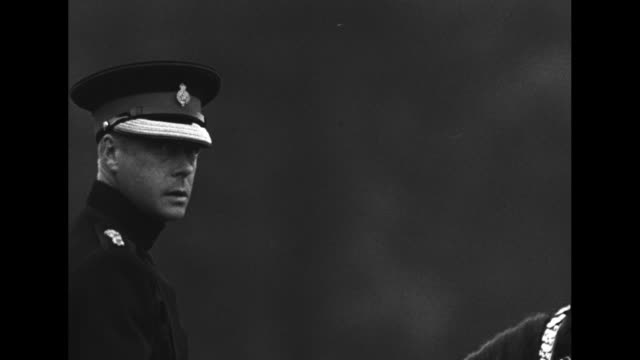 side cu king edward viii looks past camera as he sits on horseback during inspection of life guards at windsor great park he wears cap with life... - edward viii stock videos & royalty-free footage
