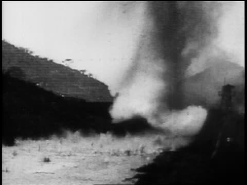 b/w 1906 side of mountain being dynamited debris falling into canal / construction of panama canal - anno 1906 video stock e b–roll