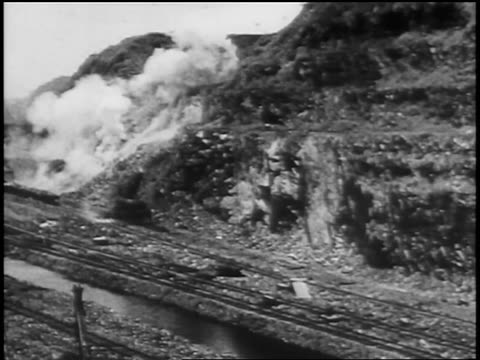 b/w 1906 side of mountain being dynamited for construction of panama canal / newsreel - panama canal stock videos & royalty-free footage