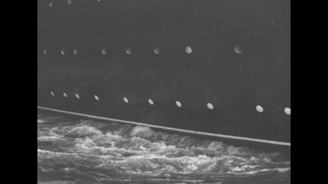 VS side of ocean liner near dock with resulting water turbulence / Note exact day not known documentation incomplete