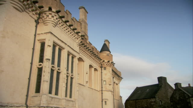 a side of stirling castle features windows, turrets, and crenelations. available in hd. - stirling stock videos & royalty-free footage