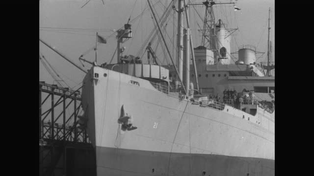 of side of uss wakefield showing row of lifeboats clinging to side - 1941 stock-videos und b-roll-filmmaterial