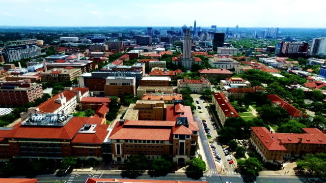 Side Pan Motion Clip Extreme High Contrast shot UT Tower and skyline in the distance Aerial Fly by Austin Texas Over University of Texas