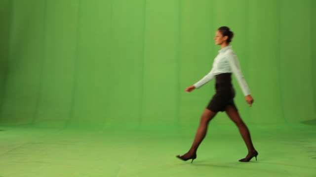 side profile of a businesswoman walking  - one person stock videos & royalty-free footage