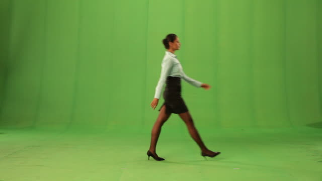 Side profile of a businesswoman walking