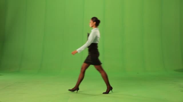 Side profile of a businesswoman walking