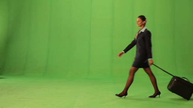 vidéos et rushes de side profile of a cabin crew walking  - fond vert