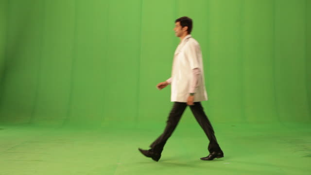 Side profile of a doctor walking