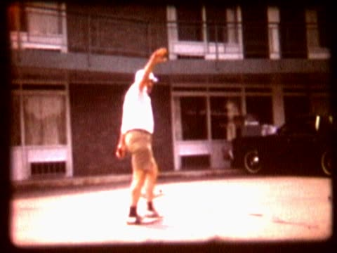 side profile of a man waving8mm home movie of waving man walking past cars and buildings - human limb stock videos & royalty-free footage