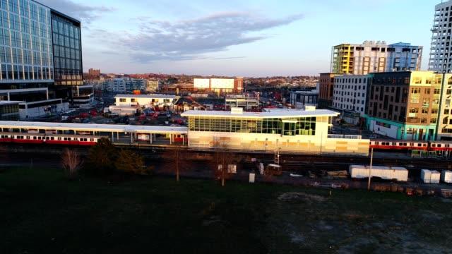side profile of boston 't' orange line subway train - dronebase stock videos & royalty-free footage