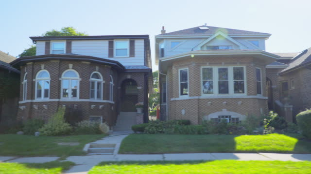 side pov row of bungalow homes chicago - residential district stock videos & royalty-free footage