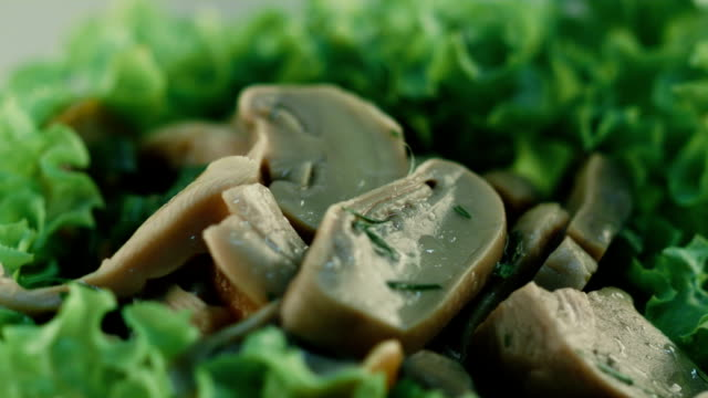 side salad. mushrooms with greens. close up - savory food stock videos and b-roll footage