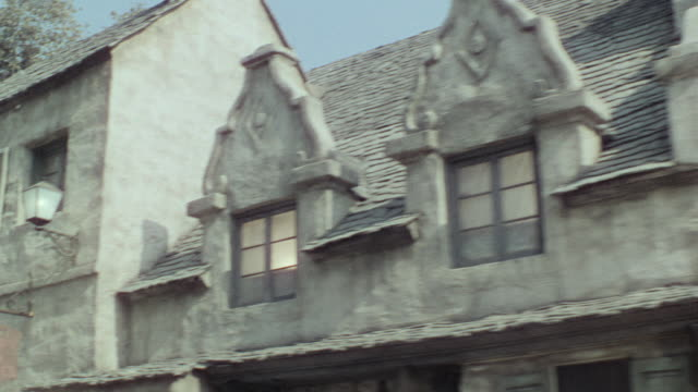 ms pov side shot of buildings in small foreign village  - facade stock videos & royalty-free footage