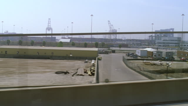 ws side pov shot of freeway and passing industrial area - passenger point of view stock videos & royalty-free footage