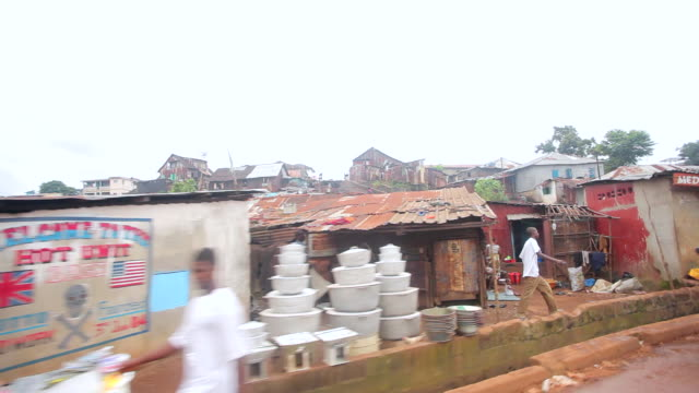 ms side pov shot of people and houses with traffic moving / freetown, sierra leone - sierra leone stock videos & royalty-free footage