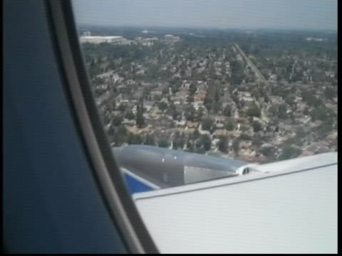 side shot out of a jetblue plane window during the carmageddon 2011 flight carmageddon refers to the epic traffic jams that were feared when the i405... - side hustle stock videos & royalty-free footage